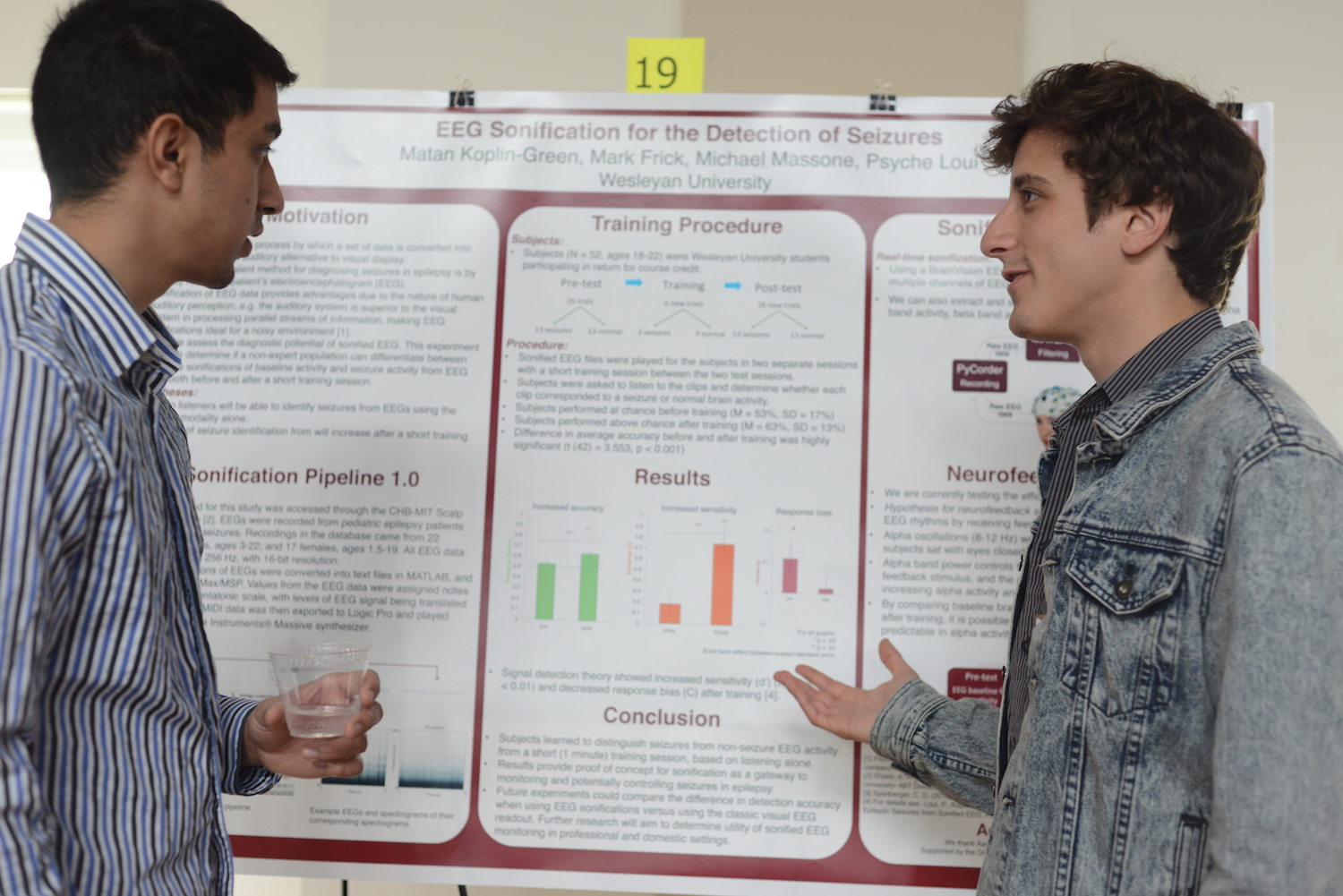 "Matan Koplin-Green '15, right, discusses his project on ""EEG Sonification for the Detection of Seizures."""
