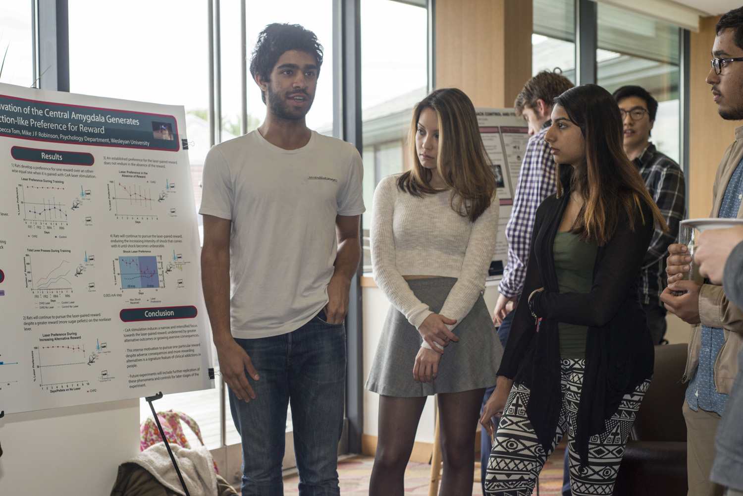 "From left, Aarit Ahuja '16, Rebecca Tom '16, and Vaishvi Jhaveri '18. Ahuja and Tom presented their poster titled, ""Optogenetic Activation of the Central Amygdala Generates Addiction-Like Preference for Reward."""