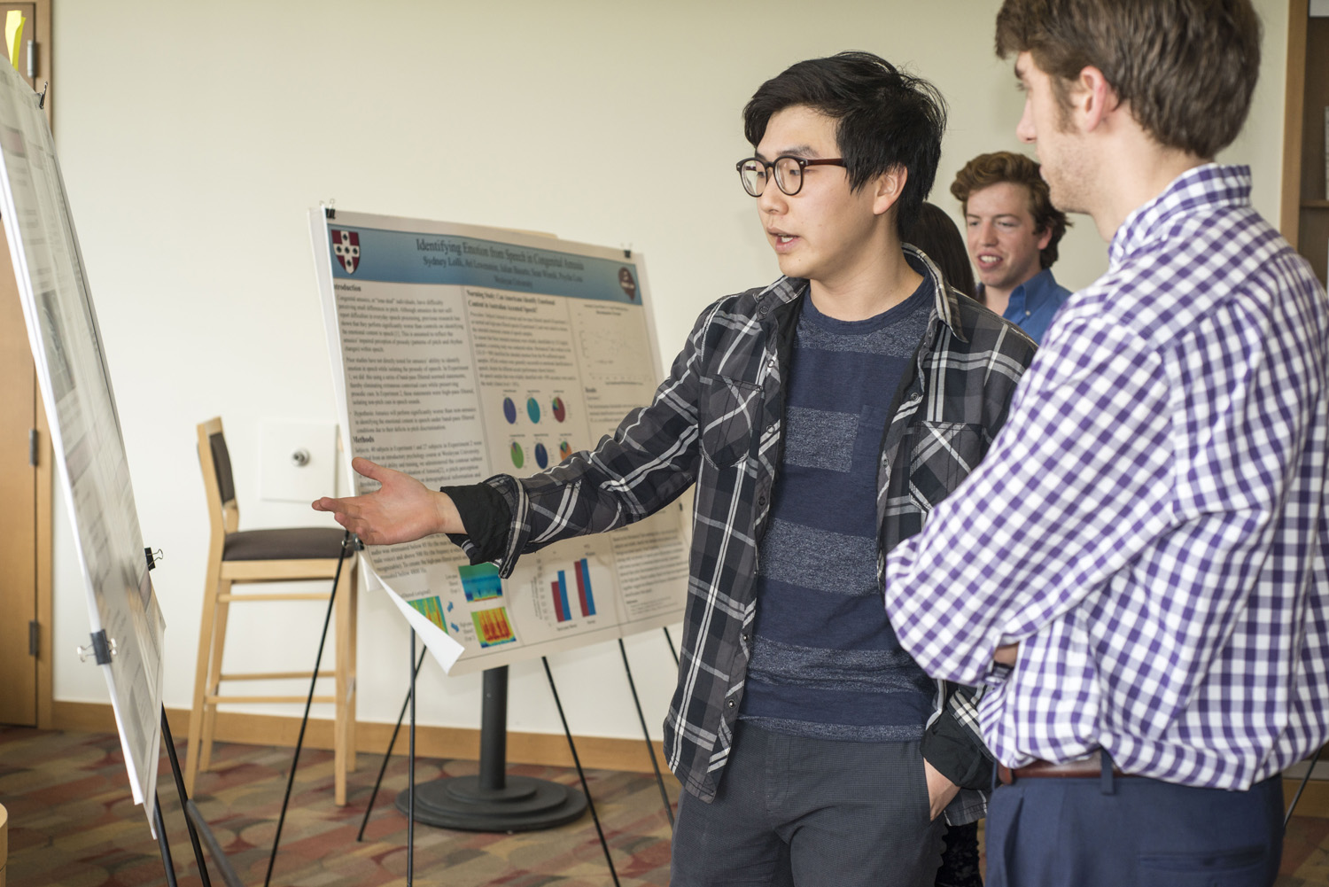 "Min Cheol Lee '15 presented his poster, ""Investigating Voice Feedback Control and its Possible Relationship with Empathy."""