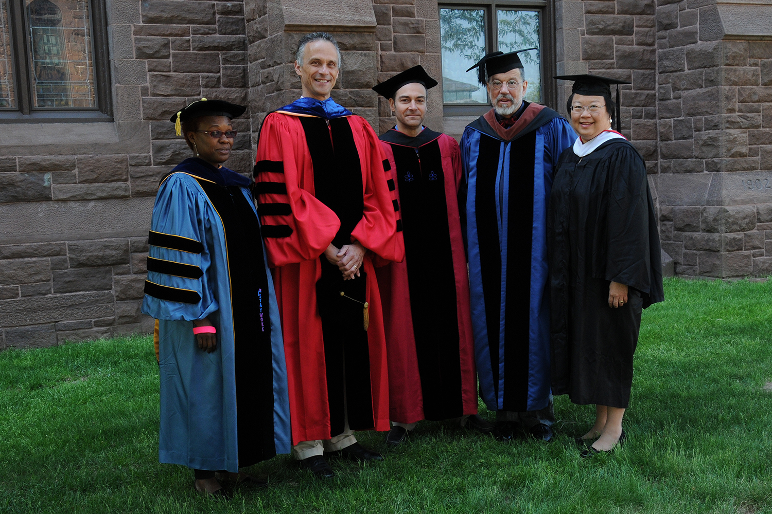 Wesleyan President Michael Roth (second of left) and Daphne Kwok '84, chair of the Wesleyan Alumni Association 9fifth from left) presented The Binswanger Prize for Excellence in Teaching to Gina Athena Ulysse (at left), Michael Calter and David Schorr. (Photo by John Van Vlack)