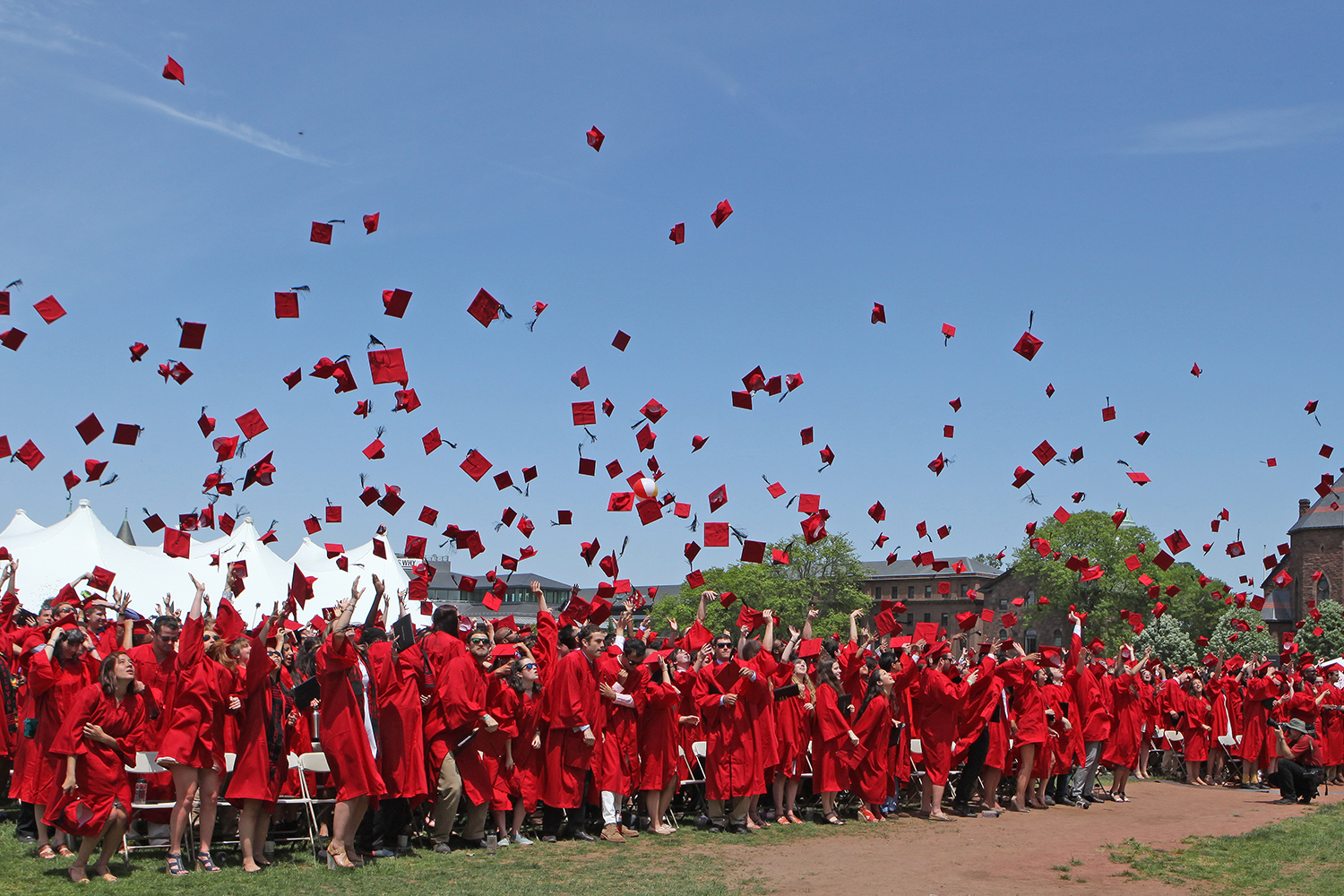 New graduates toss hats following the 183rd Commencement Ceremony May 24.