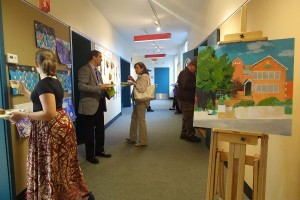 Visitors view the art at the Green Street anniversary celebration.  (photo c/o Lu Imbriano )