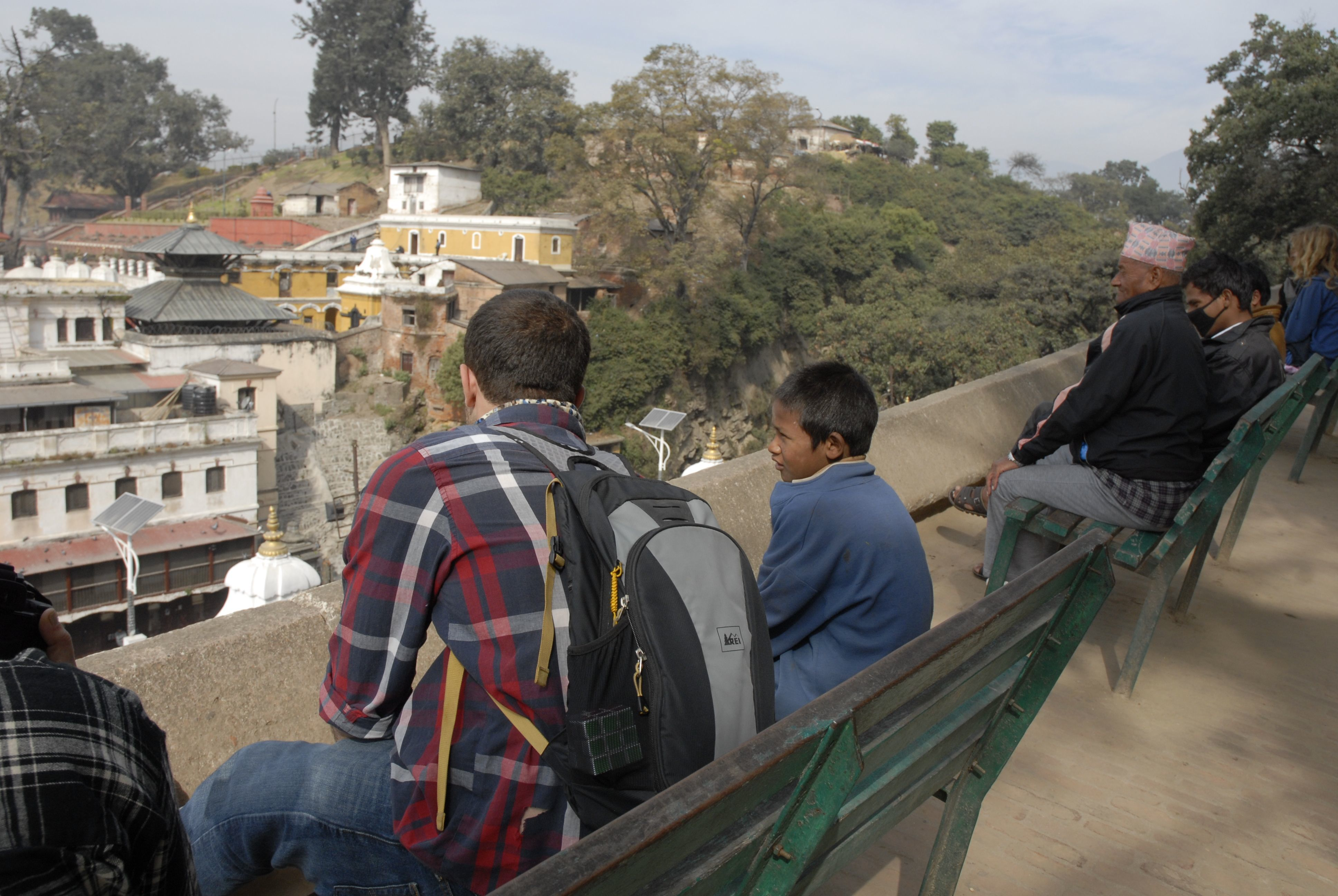 Michael Greenwald '16 speaking with a street boy who had approached him at Pashupatinath Temple.