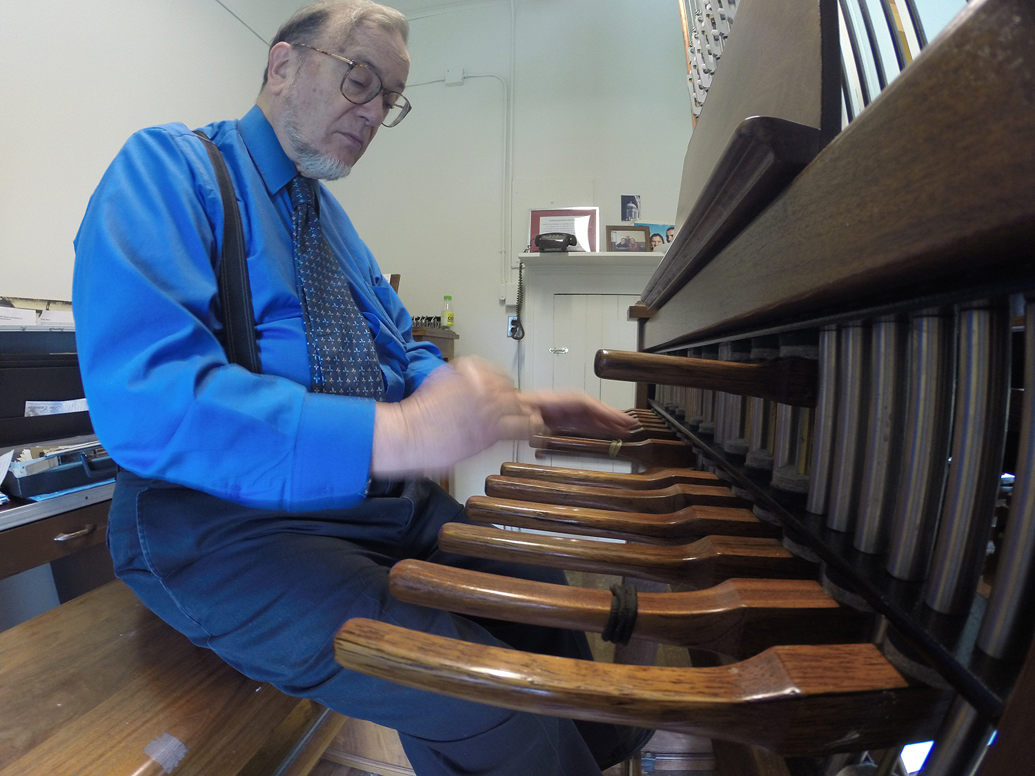 George Matthew plays the 24-bell carillon atop South College.