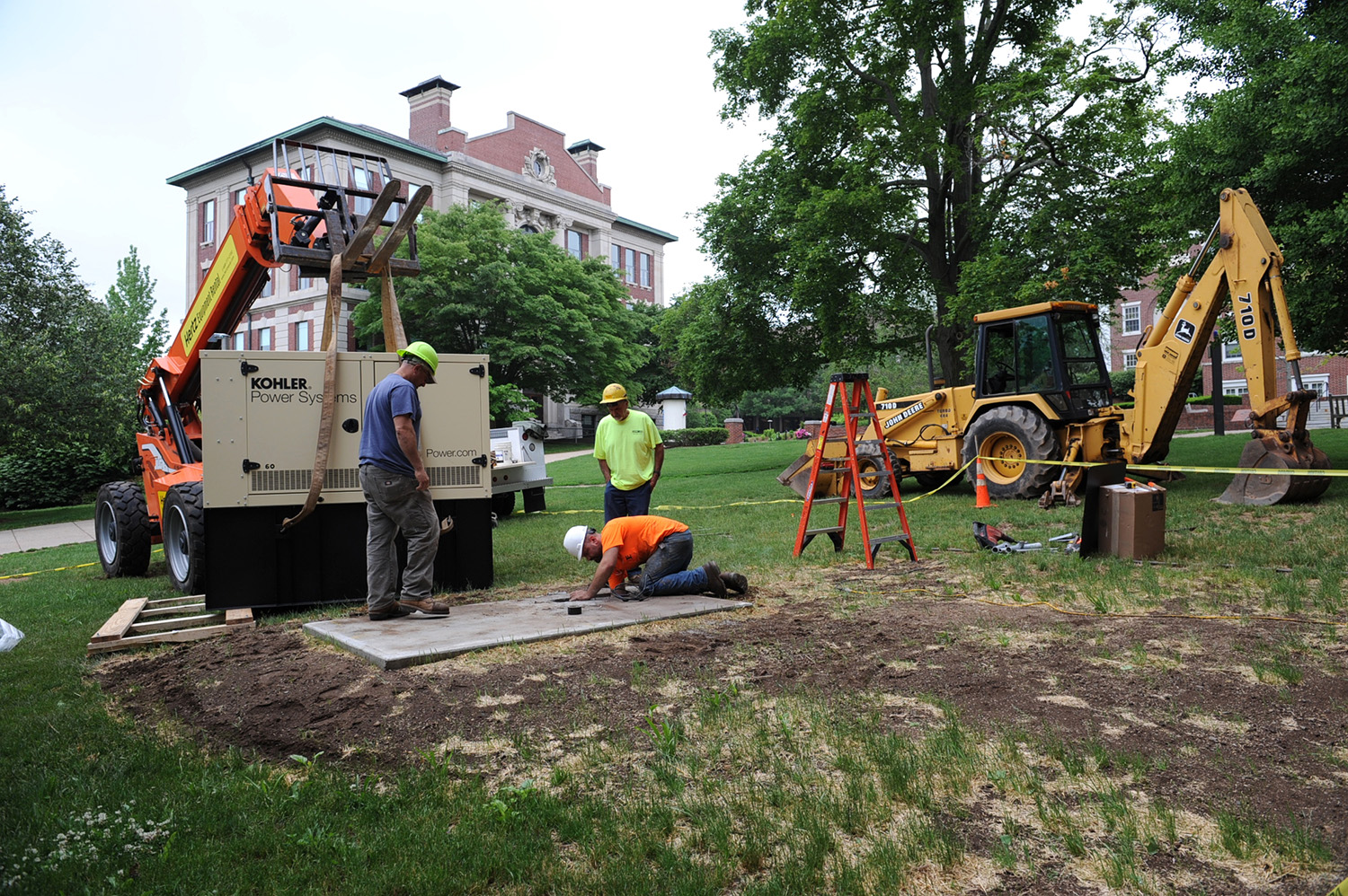 Workers installed a new generator at Judd Hall in early June.