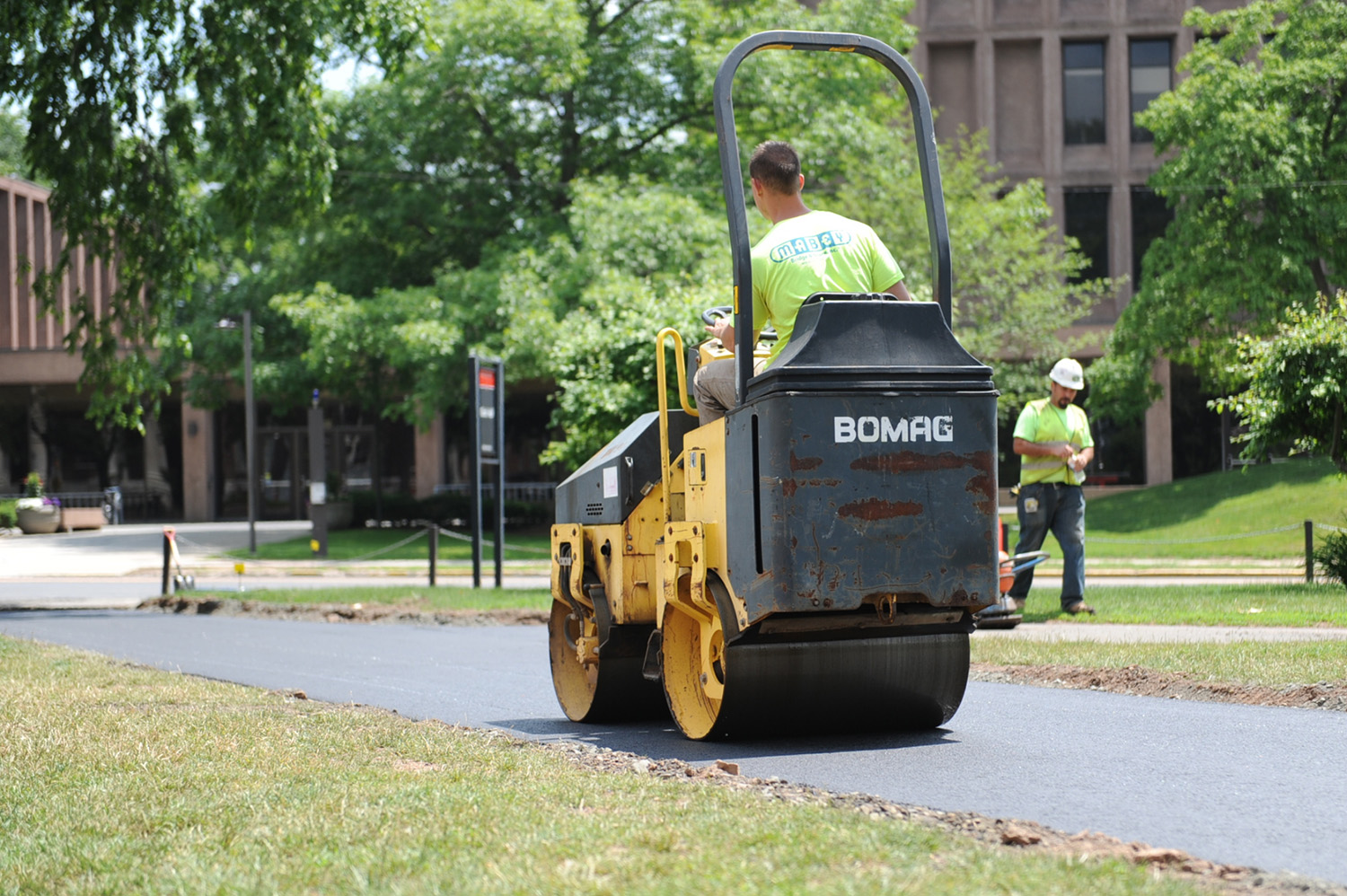 The asphalt sidewalks are being replaced throughout the Foss Hill complex.