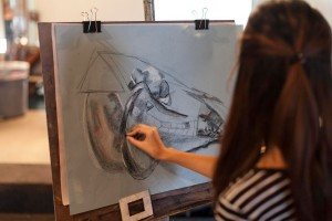 A student sketches animal skulls in Kate Ten Eyck's Drawing I class.