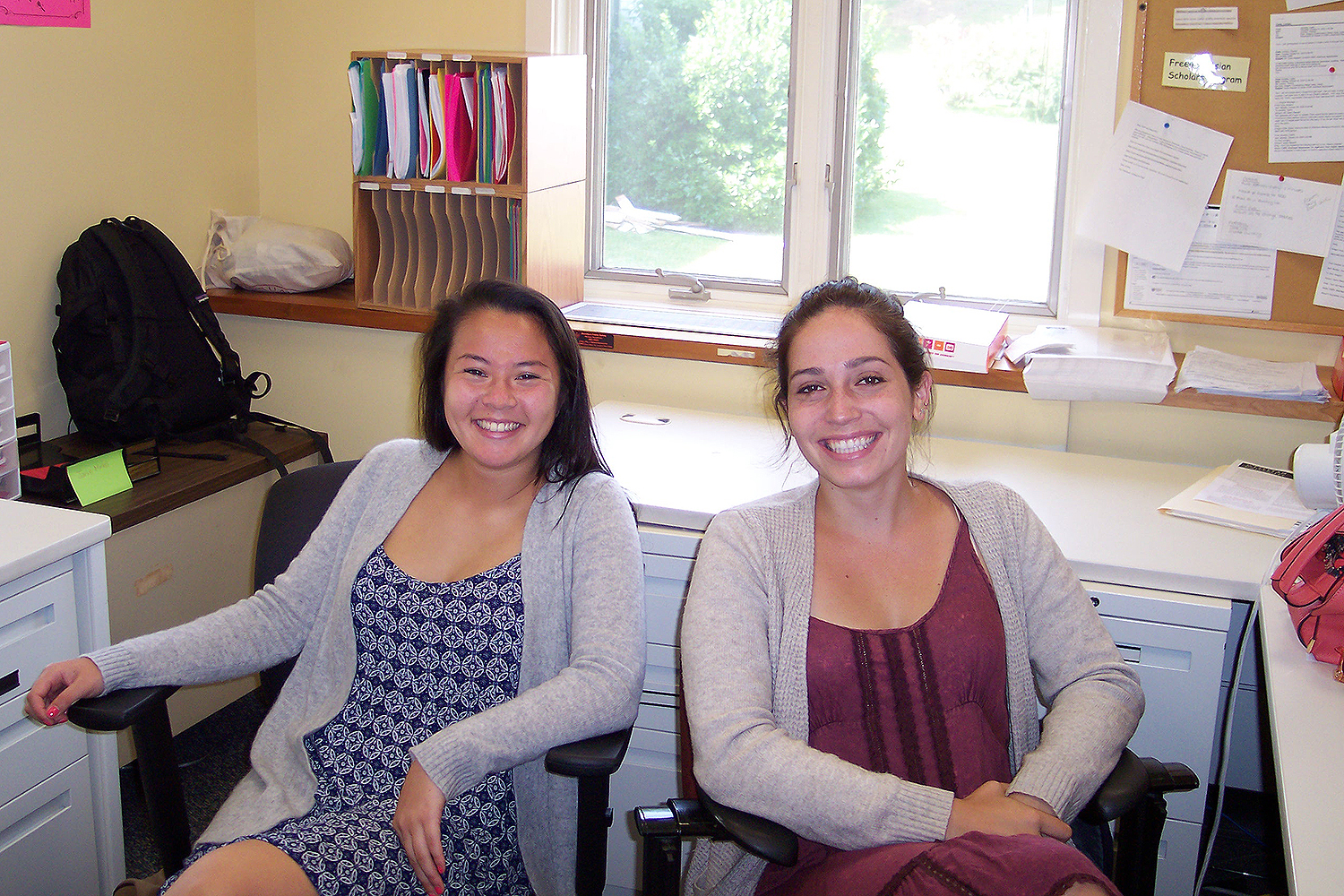 "At left, neuroscience and behavior and Science in Society Program major Lauren Yue '17 and East Asian studies major Abby Gruppuso '16 are employed by the Office of Admission. This summer, they are working as student tour guides. Yue says her job allows her to meet people from all around the world. ""It's a lot of fun and I enjoy interacting with everyone I meet,"" she said. Gruppuso enjoys working with parents in particular. ""They're excited to be here and they really like that their child is checking out Wesleyan."" she said."