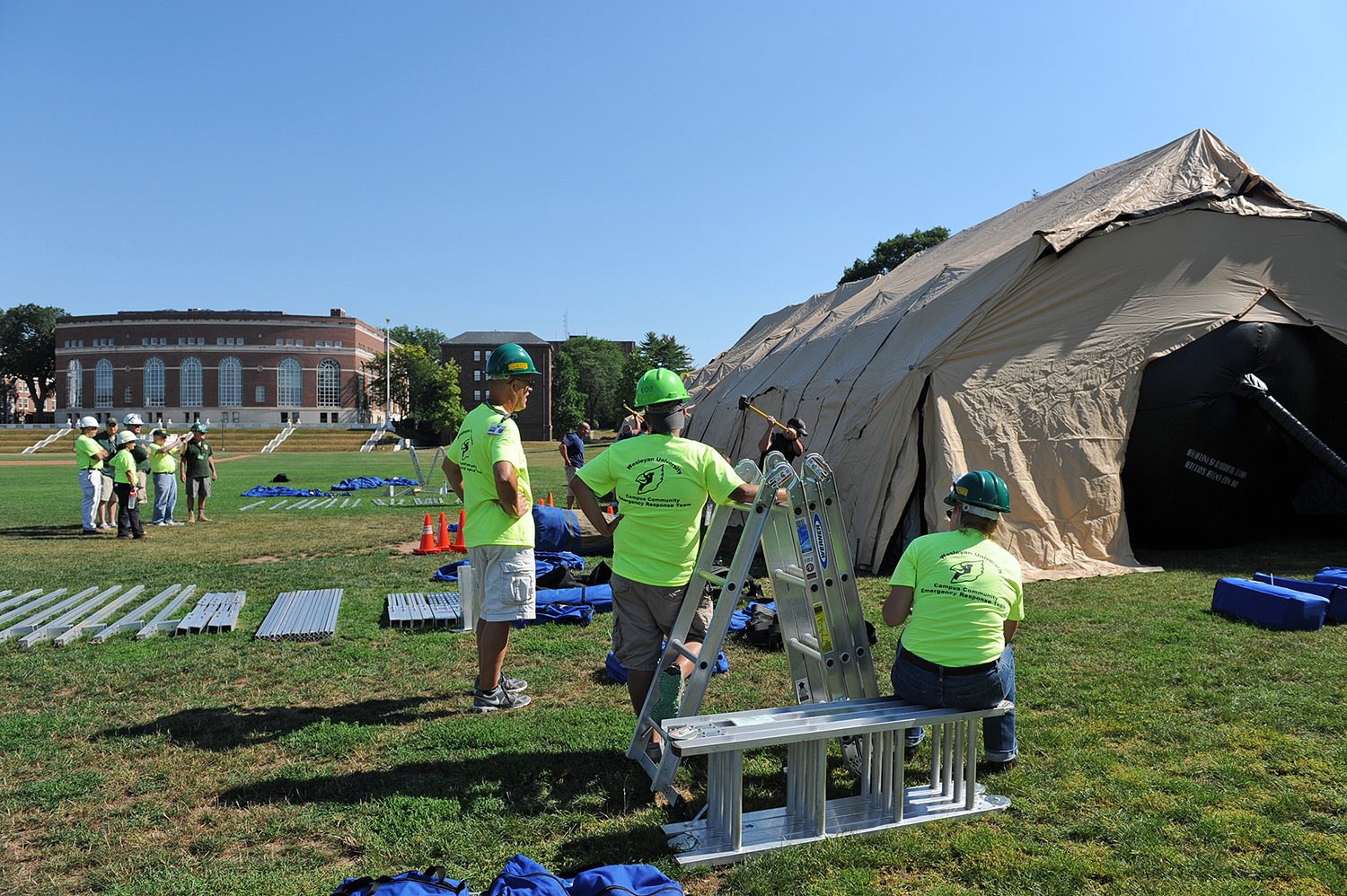 On Aug. 3, more than 20 Wesleyan employees helped erect a tent that could be used as a mobile hospital in the event of an emergency situation. Members of Wesleyan's Campus Community Emergency Response Team (C-CERT) constructed the mobile unit with guidance from Middletown Emergency Management and Middletown Fire Department.