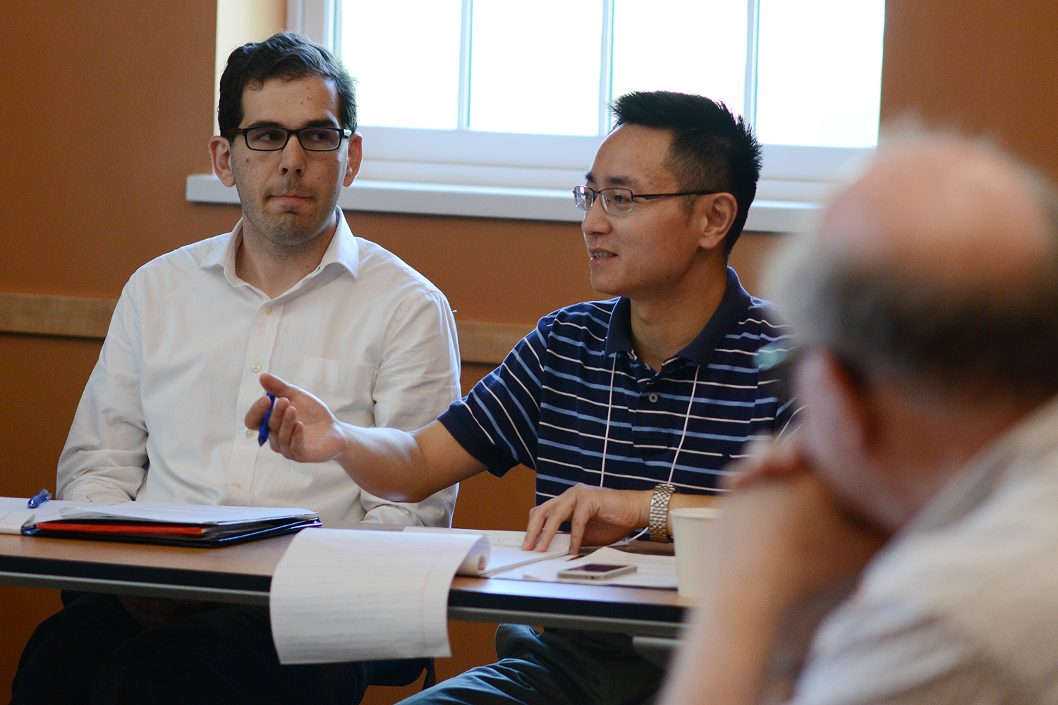 "Liang Ding, professor of international finance and financial markets at Macalester, led a session on ""Teaching Our Research."" Ding asked conference participants to elaborate on ways they integrate their research into teaching and how to teach finance in a liberal arts setting. Ding's research focuses on the impact of market structure and market participants' behavior on asset prices in financial markets."