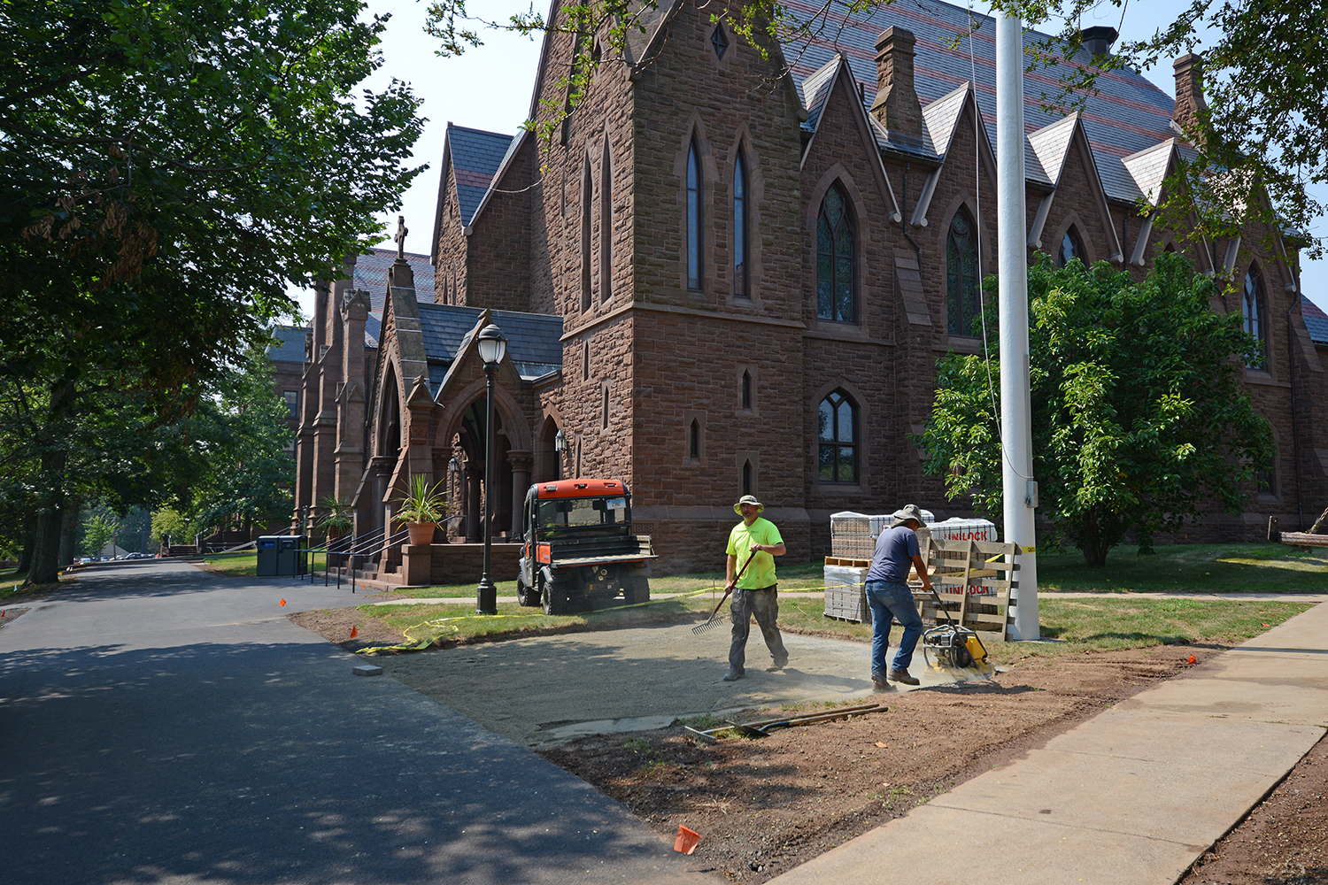 Crews lay stone for a patio between Memorial Chapel and South College on Aug. 19.