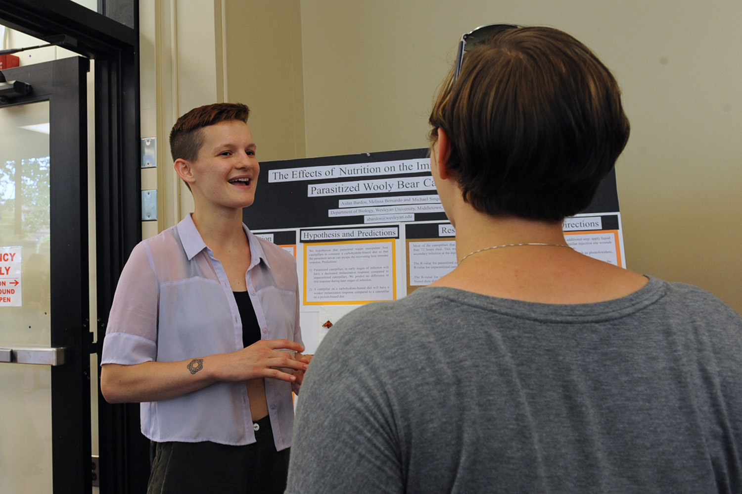 "Aidan Bardos '17 presented her research titled ""The Effects of Nutrition on the Immune Response of Wooly Bear Caterpillars Infected by Parasitoid Wasps."" Bardos' faculty advisor is Michael Singer, associate professor of biology and environmental studies."