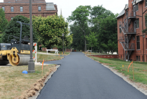 The new asphalt path on College Row is 13-feet wide.