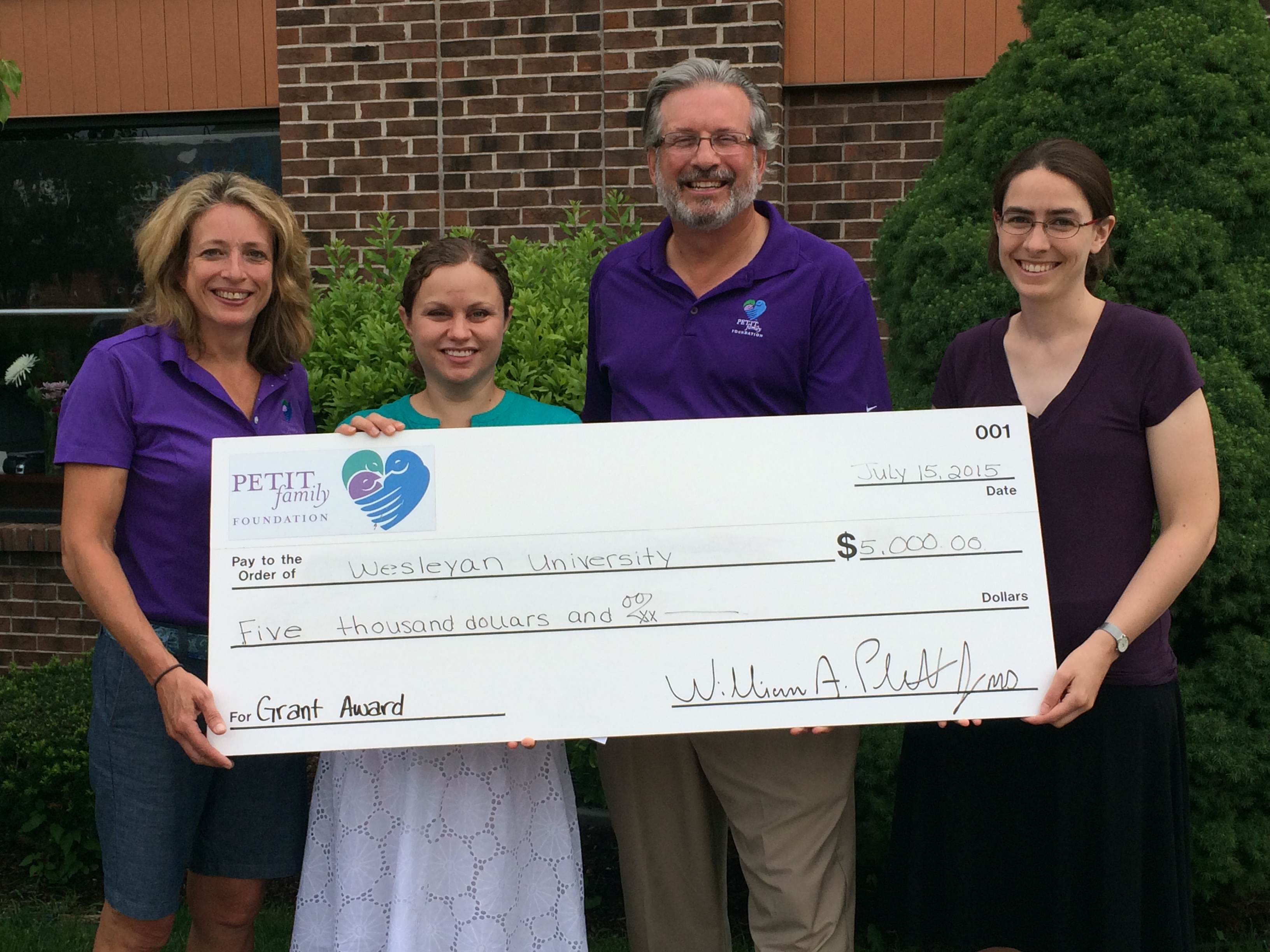 On July 15, the Petit Family Foundation awarded Wesleyan's Physics Department with a $5,000 grant to support the 2016 Northeast Conference for Undergraduate Women in Physics (CUWiP). Pictured, from left is Kimberly Petit, Chris Othon, William Petit and Meredith Hughes.