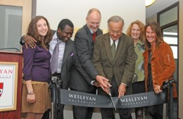 The Patricelli Center, opened in 2011, is working to close a funding gap. At the May 2011 ribbon cutting for the center, from left to right, are Jessica Posner Odede '09, Kennedy Odede '12, Board of Trustees Chair Joshua Boger '73, P '06, P '09, Bob Patricelli '61, P '88, P'90, Margaret PatricelliP '88, P'90, and Alison Patricelli '90.