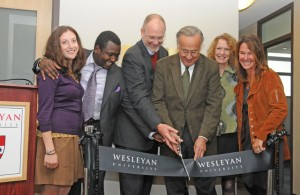 The Patricelli Center, opened in 2011, is working to close a funding gap. At the May 2011 ribbon cutting for the center, from left to right, are Jessica Posner Odede '09, Kennedy Odede '12, Board of Trustees Chair Joshua Boger '73, P '06, P '09, Bob Patricelli '61, P '88, P'90, Margaret Patricelli  P '88, P'90, and Alison Patricelli '90.  (Photo by Olivia Drake.)
