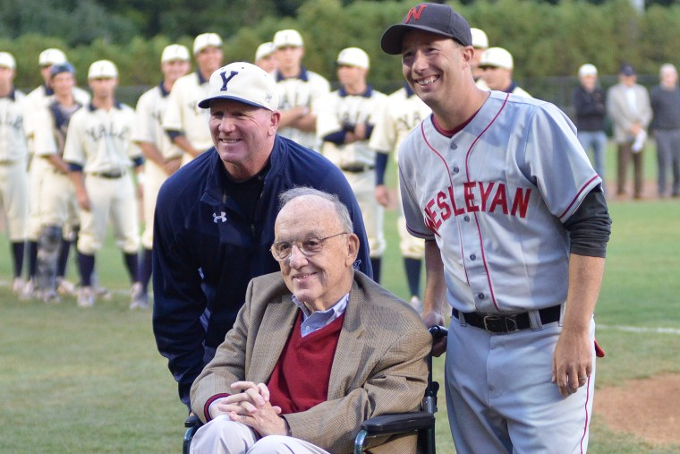 At left, Yale University head coach John Stupe and Wesleyan head coach Mark Woodworth welcomed Fay Vincent to the reenactment game. Vincent served as the Commissioner of Major League Baseball from 1989 to 1992.