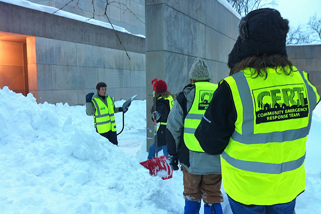 During Winter Storm Nemo in 2013, the C-CERT team worked to inspect and clear all emergency exits near academic and administrative buildings. Pictured at left is Jennifer Curran.