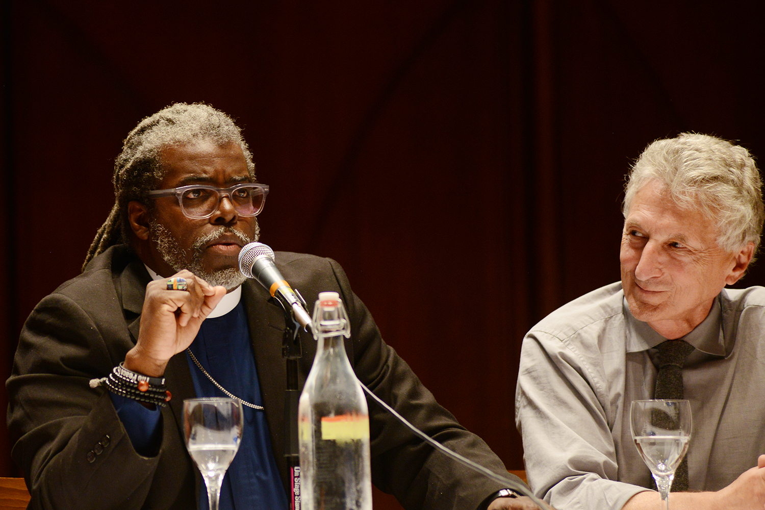At right, Rob Rosenthal, director of the Allbritton Center for the Study of Public Life, John E. Andrus Professor of Sociology, listens to Rev. Selders. Rosenthal moderated the panel.