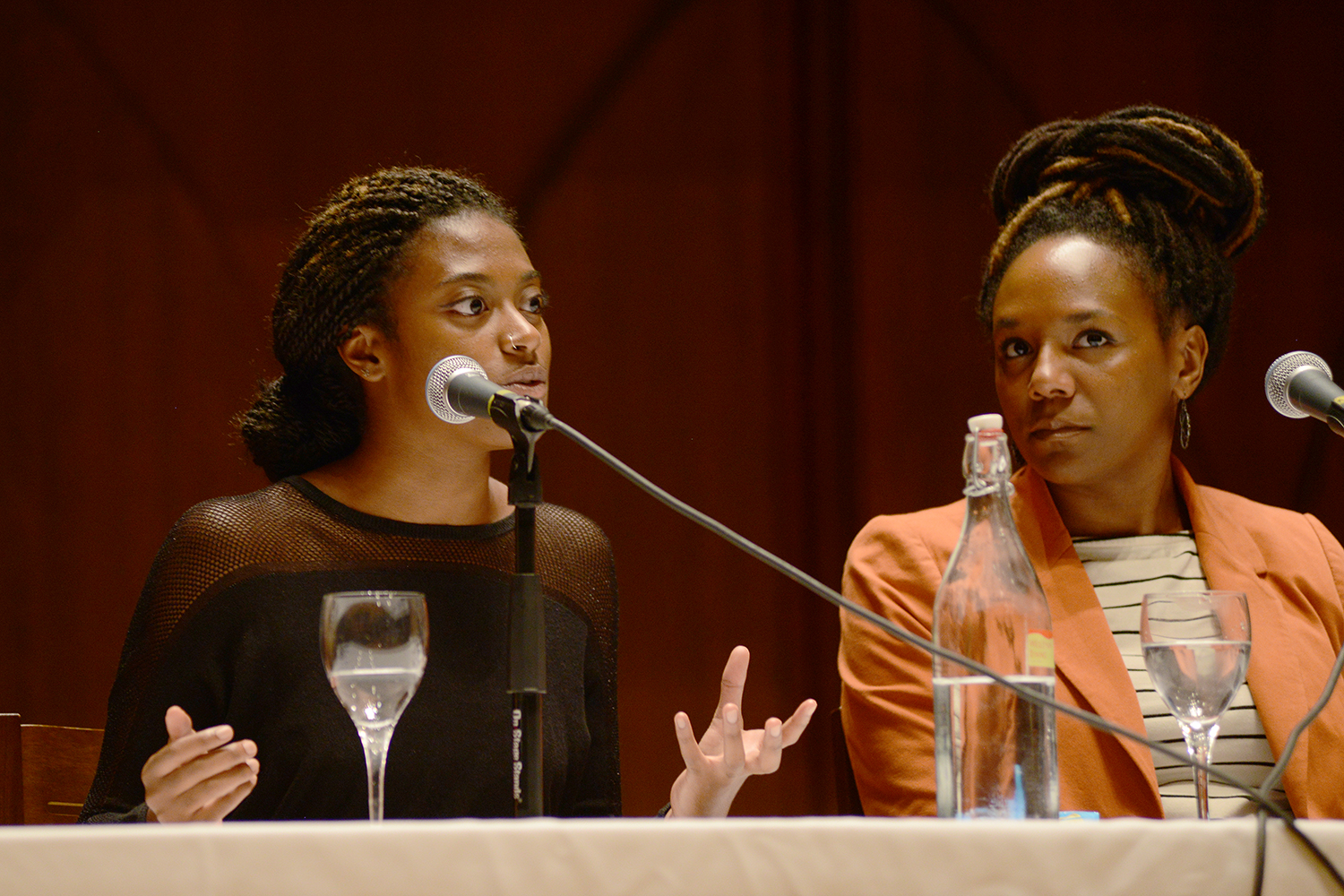 Bree Newsome, at right, listens to Tedra  James '18.