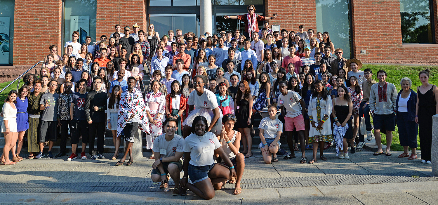 "Wesleyan international students posed for a group photo with their Orientation Leaders on Sept. 1 and learned to shout ""Go Wes!"""