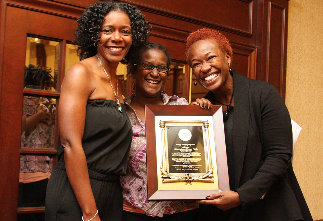 Pictured at right, Gina Ulysse received the Haitian Studies Association's Excellence in Scholarship award from association board members Régine Jackson and Nadève Menard. (Photo by Gregory Jean-Baptiste)