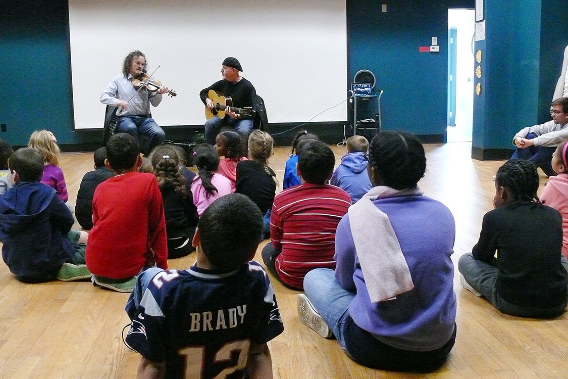 On Oct. 19, the Green Street Teaching and Learning Center and the Center for the Arts arranged for musicians Martin Hayes and Dennis Cahill to share their passion for Irish music with GSTLC AfterSchool students and staff that afternoon. The children (in grades 1-5) came to GSTCL on one of their half days from school.