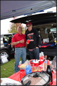 In advance of Wesleyan football's Homecoming match, various athletic teams host tailgates on Andrus Field for family, friends and alumni, with concessions provided by the baseball and softball teams. (Photo by John Van Vlack)
