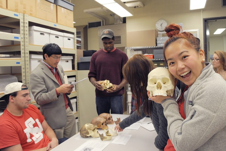 Anna Lu '17, who is enrolled in the HIST 368 class, History of Science and Technology in Modern China, holds a sample of Homo sapiens. Lu's class visited Wesleyan's Anthropology and Archaeology Collections on Nov. 11 to learn more about Chinese ancestry.