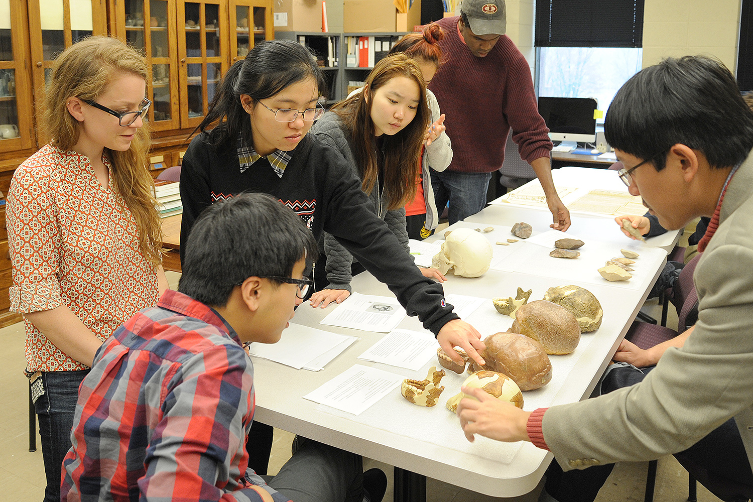 At right, Ying Jia Tan, assistant professor of history, taught his class, History of Science and Technology in Modern China, in Wesleyan's Anthropology and Archaeology Collections.
