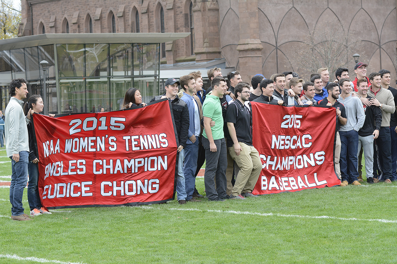 During Wesleyan's Homecoming game Saturday, Wesleyan's Director of Athletics Mike Whalen honored the achievements of outstanding student athletes. He praised the 2014-15 men's basketball team, 2015 baseball team, and tennis stars Eudice Chong '18 and Victoria Yu '19.