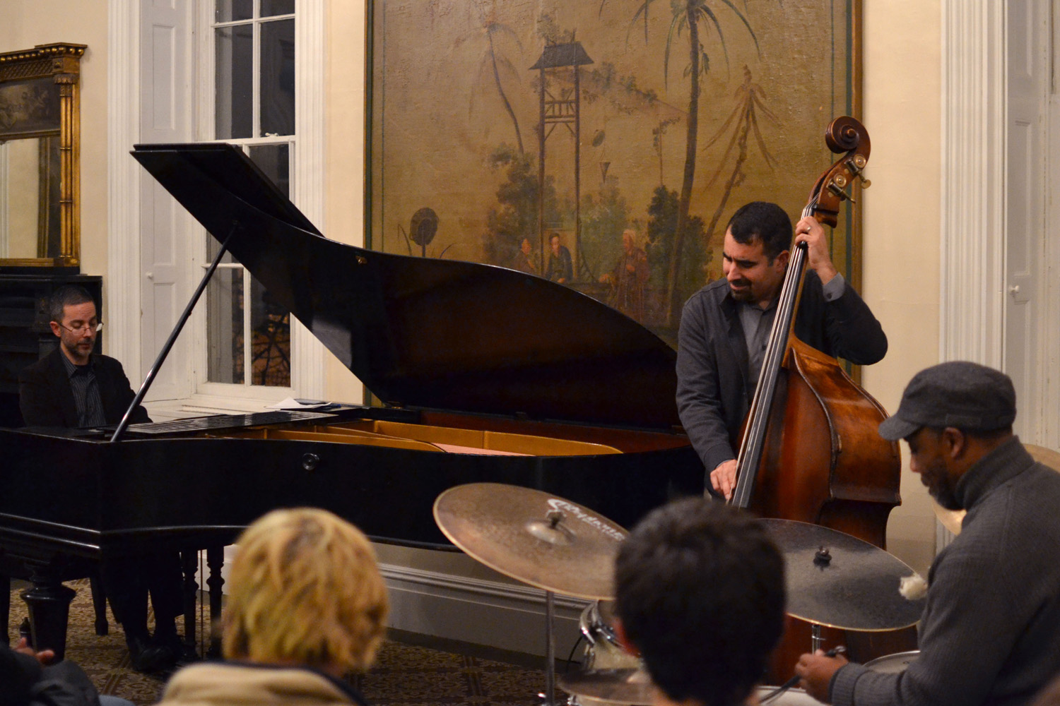 Graduate Liberal Studies hosted a combined concert and talk on Monday, November 30th entitled Monk and Mingus: The Cutting Edge of Jazz. Jazz Ensemble Coach Noah Baerman performed on piano, accompanied by bassist Henry Lugo, and Visiting Assistant Professor of Music Pheeoroan akLaff on percussion.