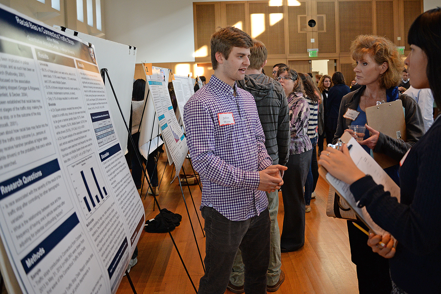 Julian Weiss '16 presented on the Racial Bias in Connecticut Traffic Stops. He concluded that drivers of color might be more likely to receive a more severe penalty compared to white drivers, suggesting that racial profiling may not be restricted to biases in making the stop—it may also be reflected in how police treat drivers of different races during traffic stops.
