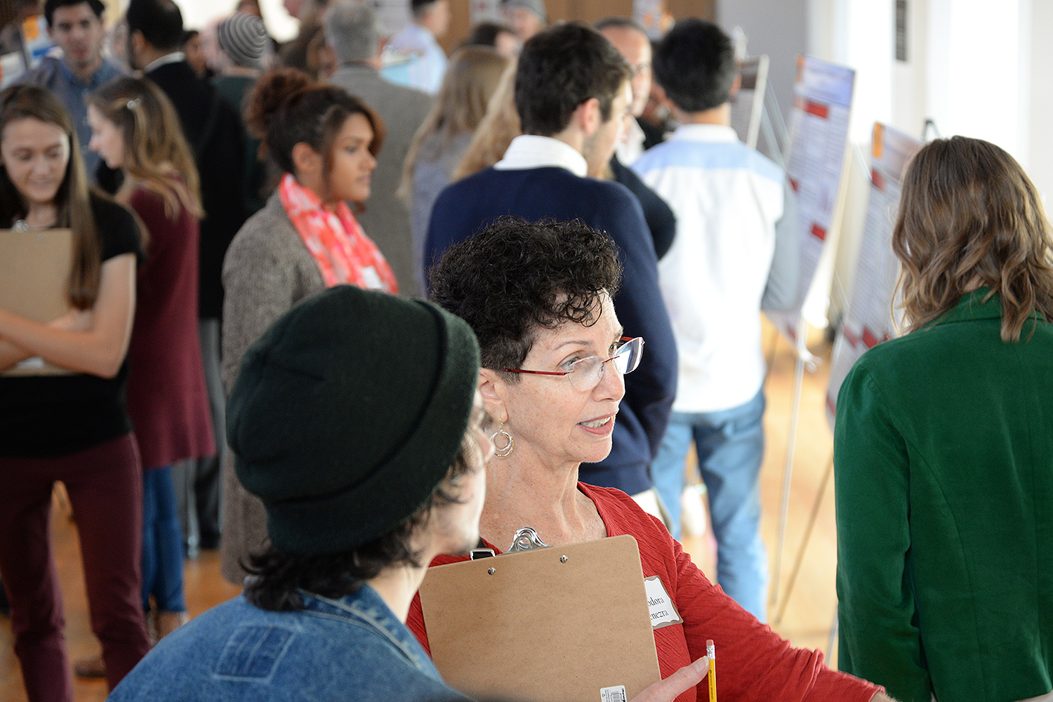 Several Wesleyan faculty, alumni and community members evaluated the students' poster presentations.