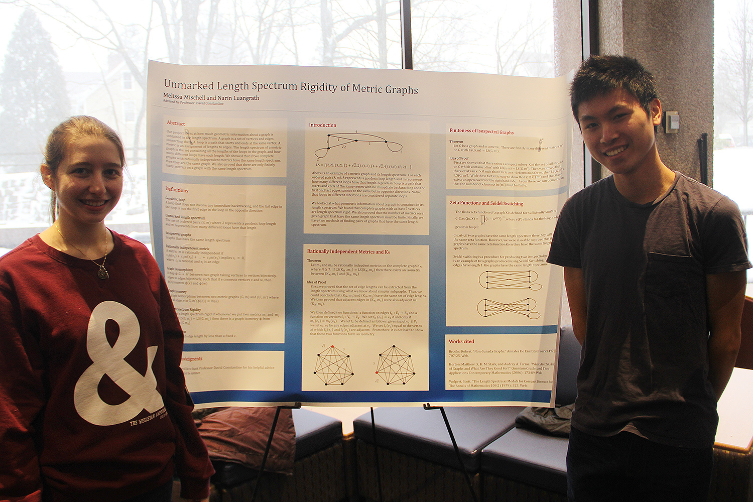 "Melissa Mischell '16 and Narin Luangrath '16 presented a poster about their research on ""Unmarked Length Spectrum Rigidity of Metric Graphs."""