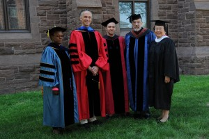 In 2015, Wesleyan President Michael Roth (second from left) and Daphne Kwok '84, chair of the Wesleyan Alumni Association (fifth from left) presented The Binswanger Prize for Excellence in Teaching to Gina Athena Ulysse (at left), Michael Calter and David Schorr. (Photo by John Van Vlack)