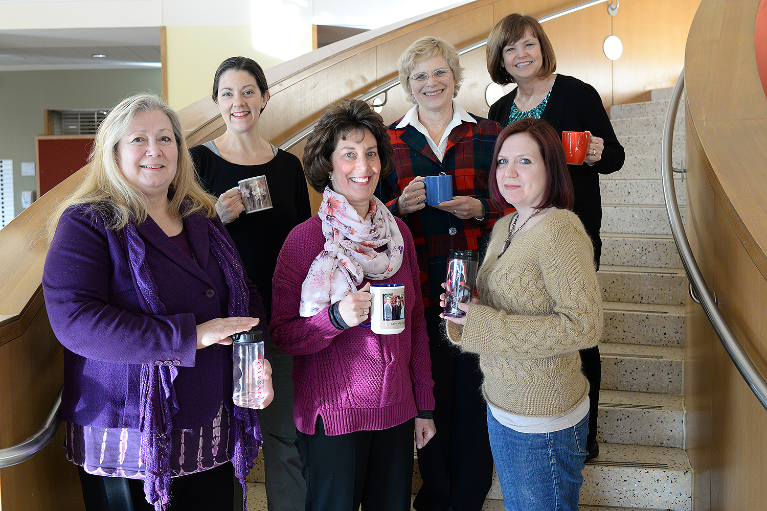 Current Green Team members, pictured here holding their reusable mugs, include, from left, Roslyn Carrier-Brault, Chemistry Department; Dawn Alger, Theater Department; Valerie Marinelli, College of the Environment; Liz Tinker, English Department; Anika Dane, Molecular Biology and Biochemistry Department; and Blanche Meslin, Biology Department.
