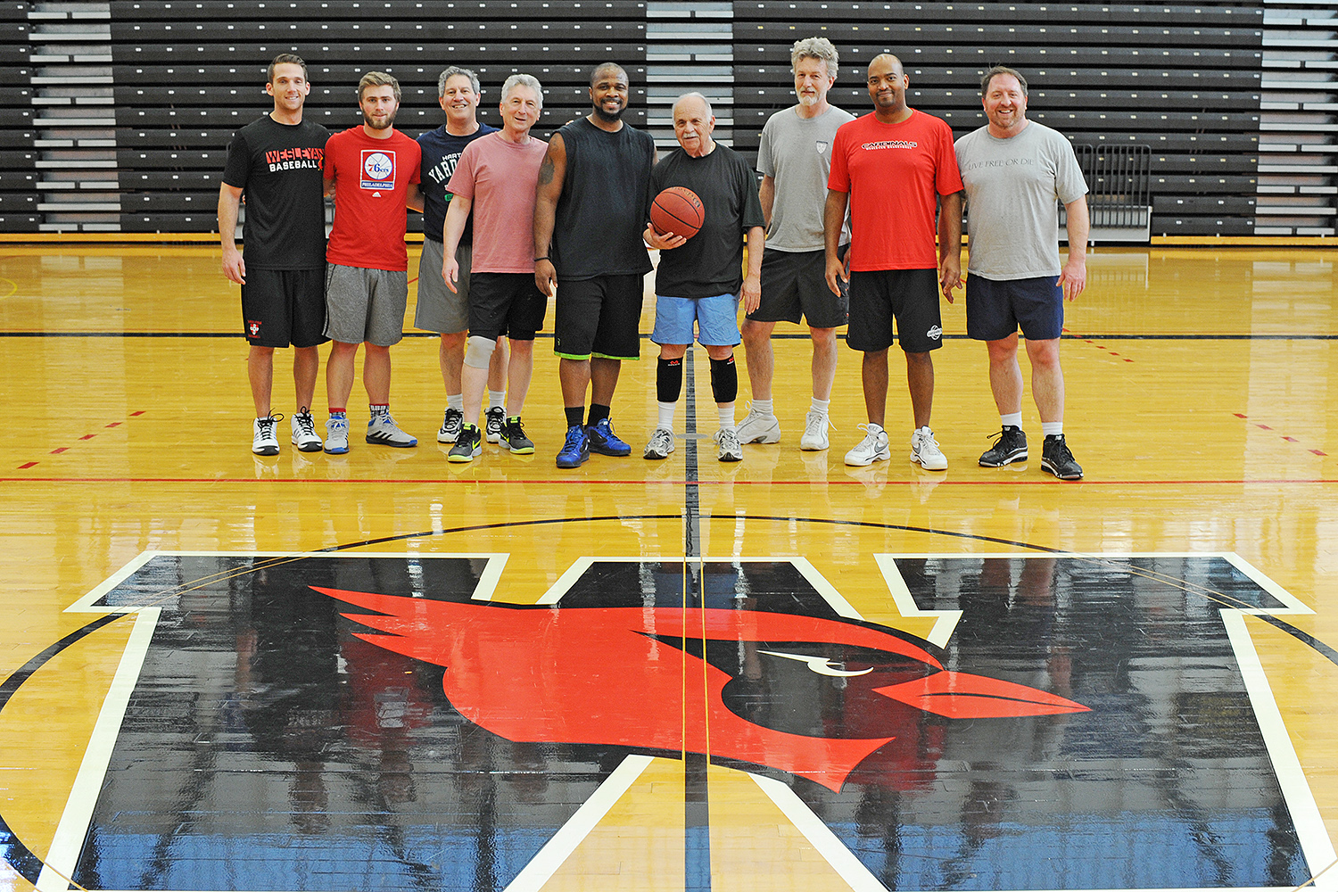 Pictured from left, are Chris Wojick, Tim Israel '16, Paul DiSanto, Rob Rosenthal, Greg Bernard, Stanley Fish, Vijay Pinch, Frantz Williams and Chuck Fedolfi.