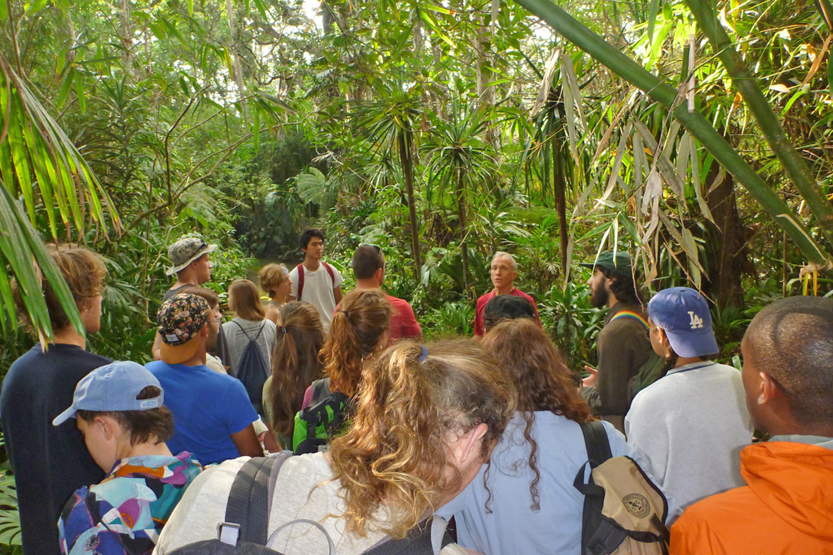 Norman Bezona, steward of the Kona Cloud Forest Sanctuary, introduces the class to the forest.