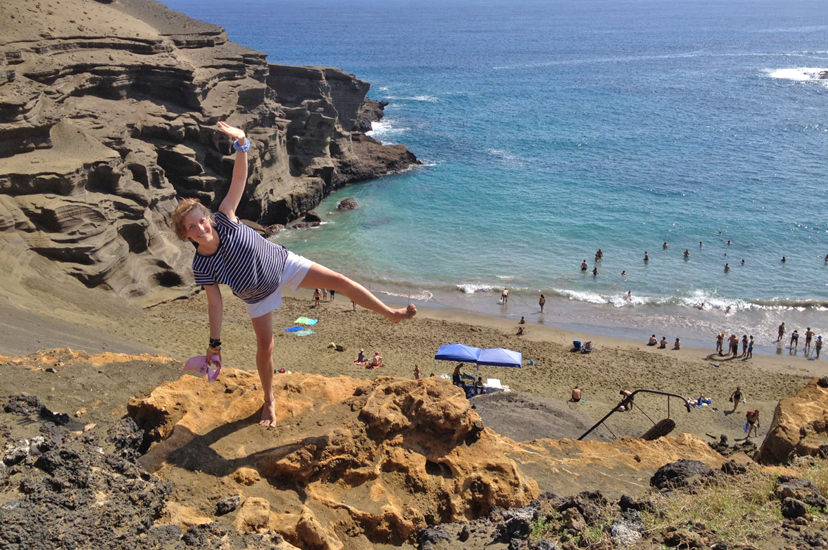 Rebecca Hanschell '16 balances above the green sand beach Papakolea. The beach is unusual due to its high concentration of olivine sand.