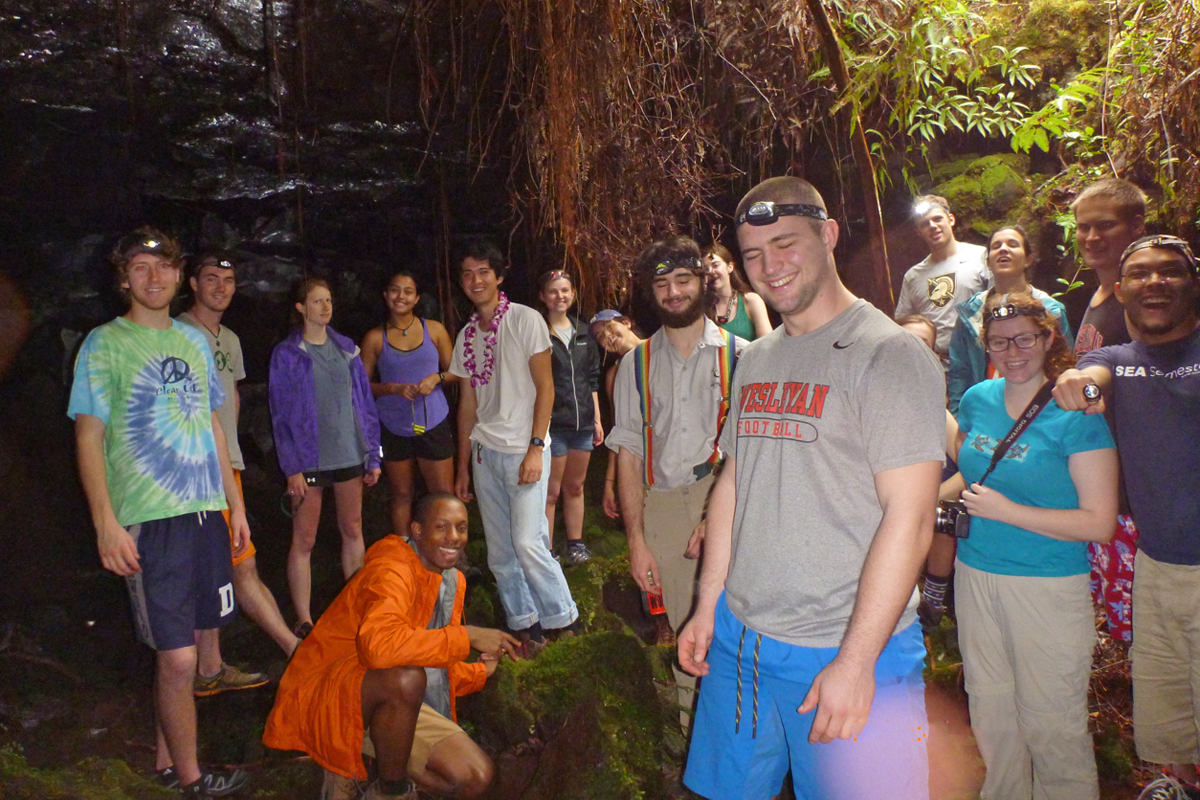 After a walk in near darkness, the class reaches an opening in the Kaumana Lava Tube.