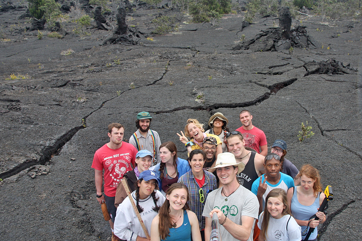 Students who are enrolled in the E&ES 397/398 Senior Seminar and Senior Field Research Project Capstone spent eight days conducting research in Hawaii. Pictured, the students gather on a lava tree field.
