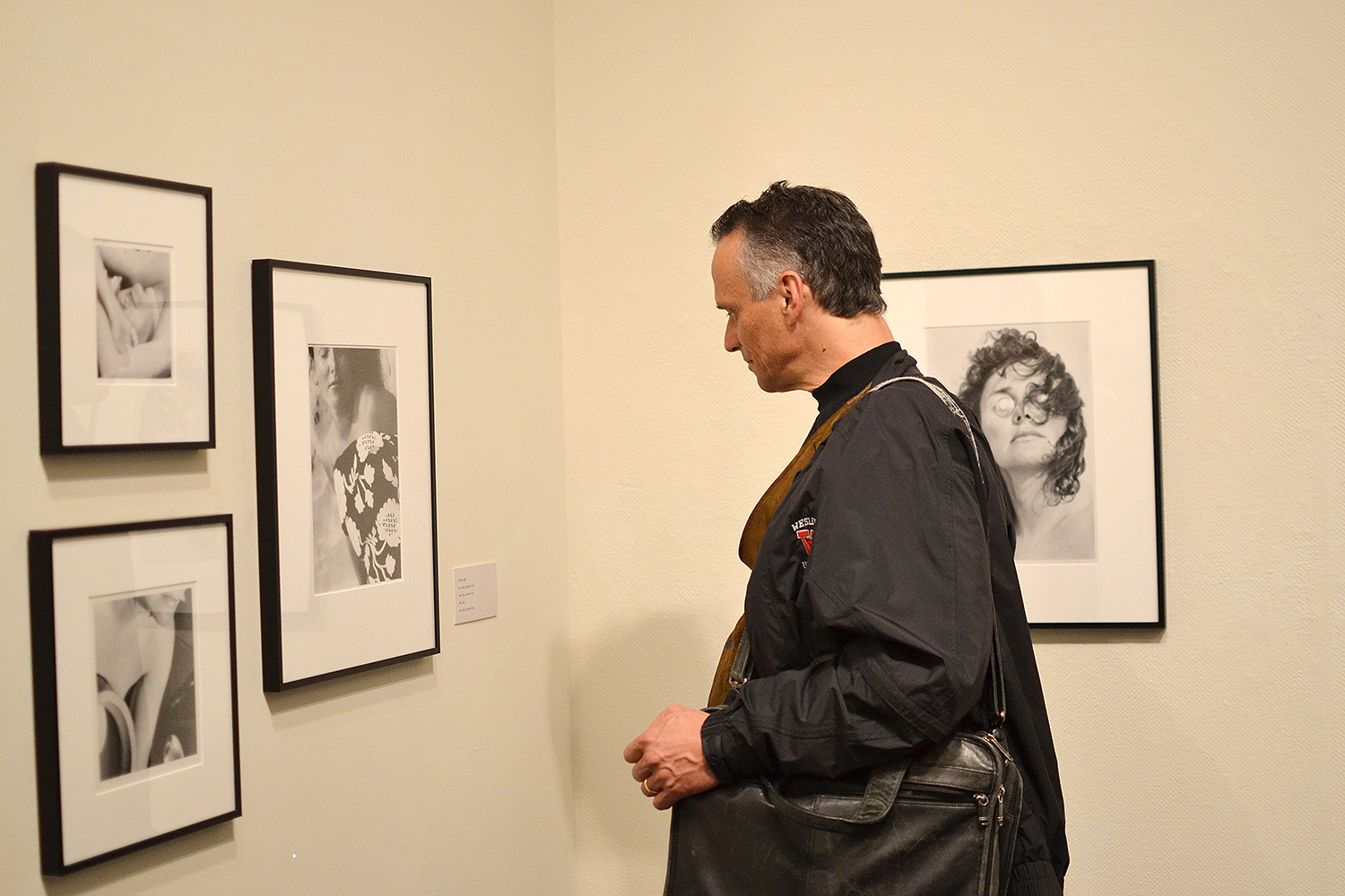 Wesleyan President Michael Roth examines Trager's black and white portraits.