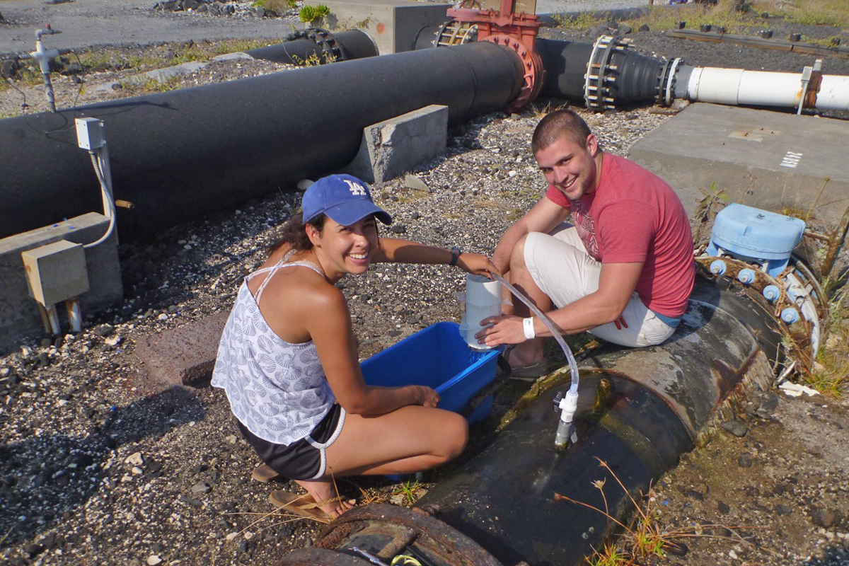 Erin McGrath '16 and John San Filippo '16 collect filter samples at the National Energy Laboratory of Hawaii Authority's 674m pipe.  The students were  analyzing the Hawaiian Coastal Biological Pump.