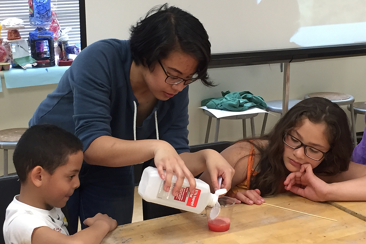 Erin Delon creates an experiment with two GSTLC students. Erin Delon creates an experiment with two GSTLC students.