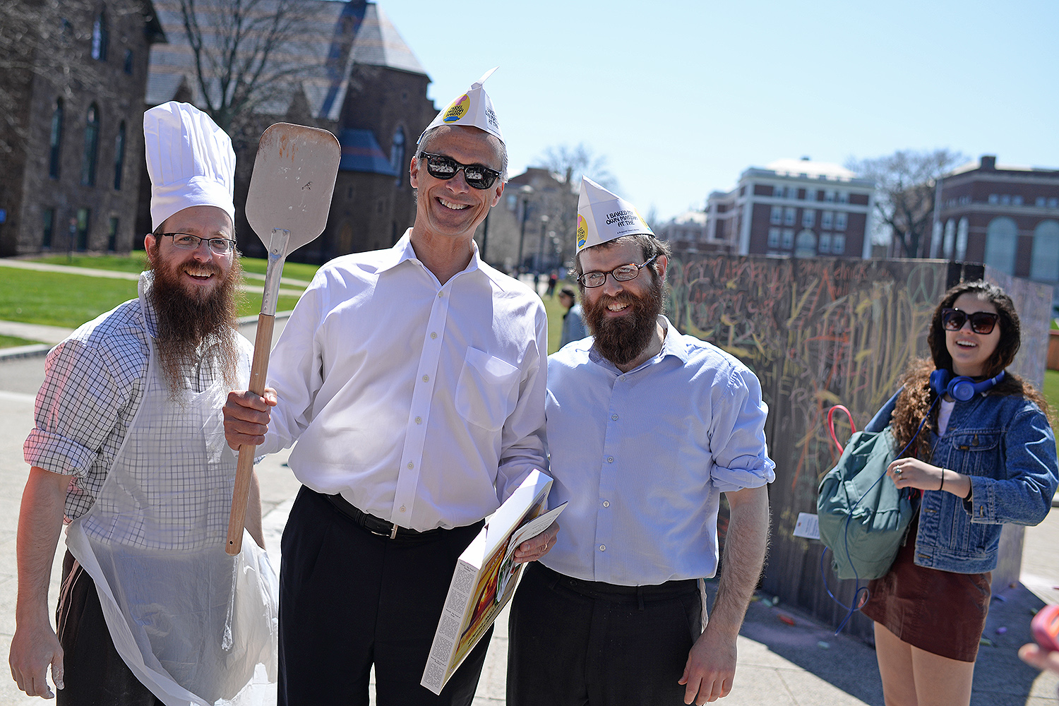 Wesleyan President Michael Roth, center, participated in the matzo bread making.