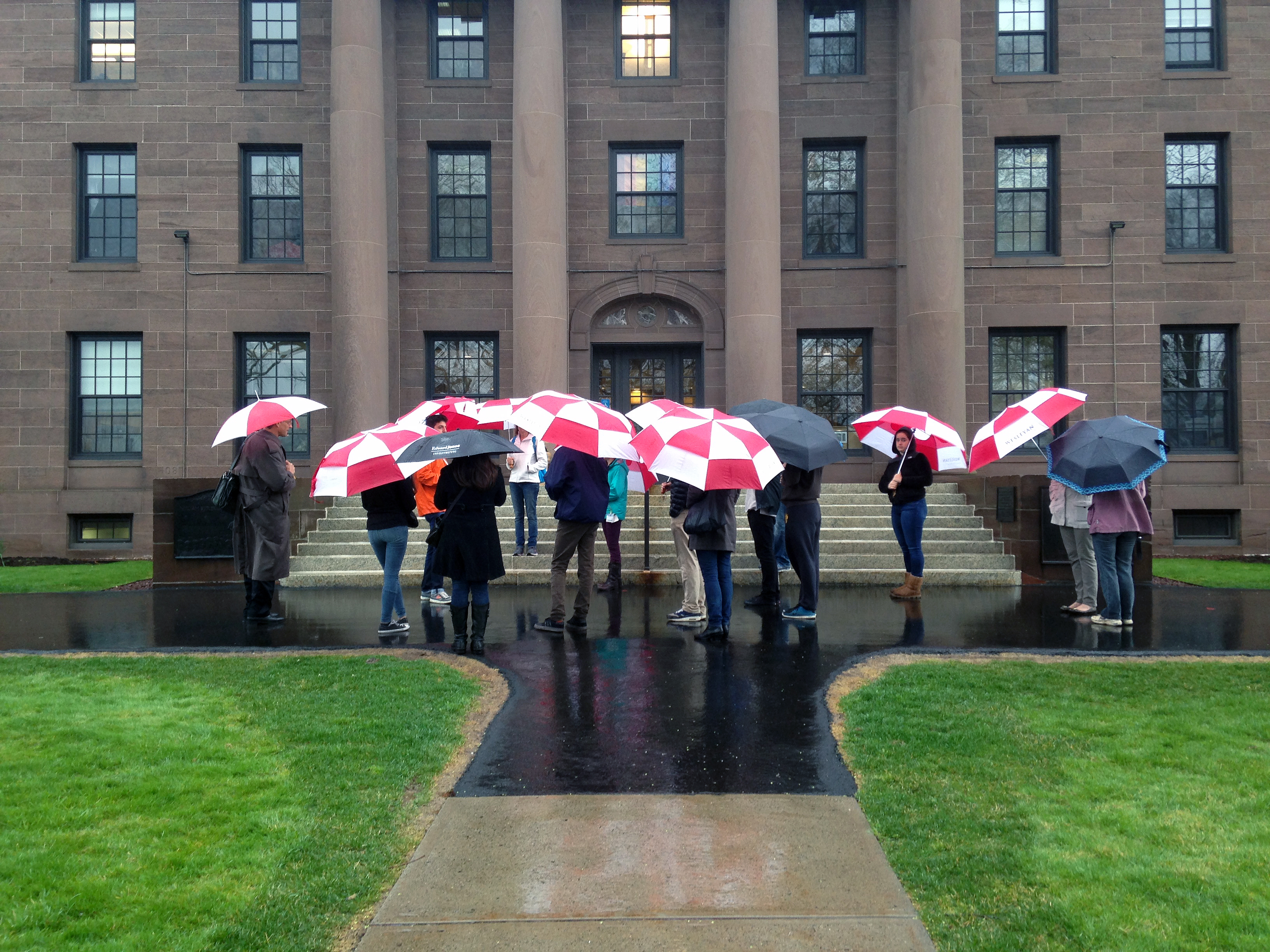 "In a moment of serendipity, Wesleyan President Michael Roth found his walk to work coinciding with the path of an Admission tour group. With his red umbrella aloft, he walked into the crowd of prospective parents and students near the steps of North College. He listened for a while before blowing his cover by asking ""Does anyone have any questions for the president this morning?""   Members of the group captured the moment on their smartphones."