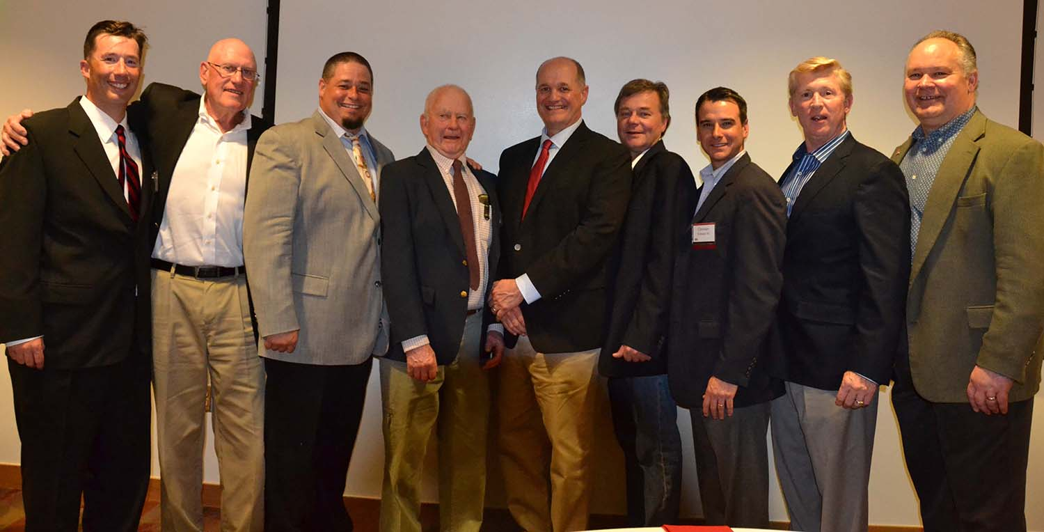 The Class of 2016 Wesleyan Baseball Hall of Fame, flanked by Baseball Coach Mark Woodworth '98 on the right and Athletic Director Mike Whalen '83 on left: Phil Rockwell '65, MALS '73 P'11; Jesse Carpenter '96; Tom Young '59, MALS '73; Steve Donovan '83, Todd Mogren '83, Christian Frattasio '00, Kevin Rose '78.