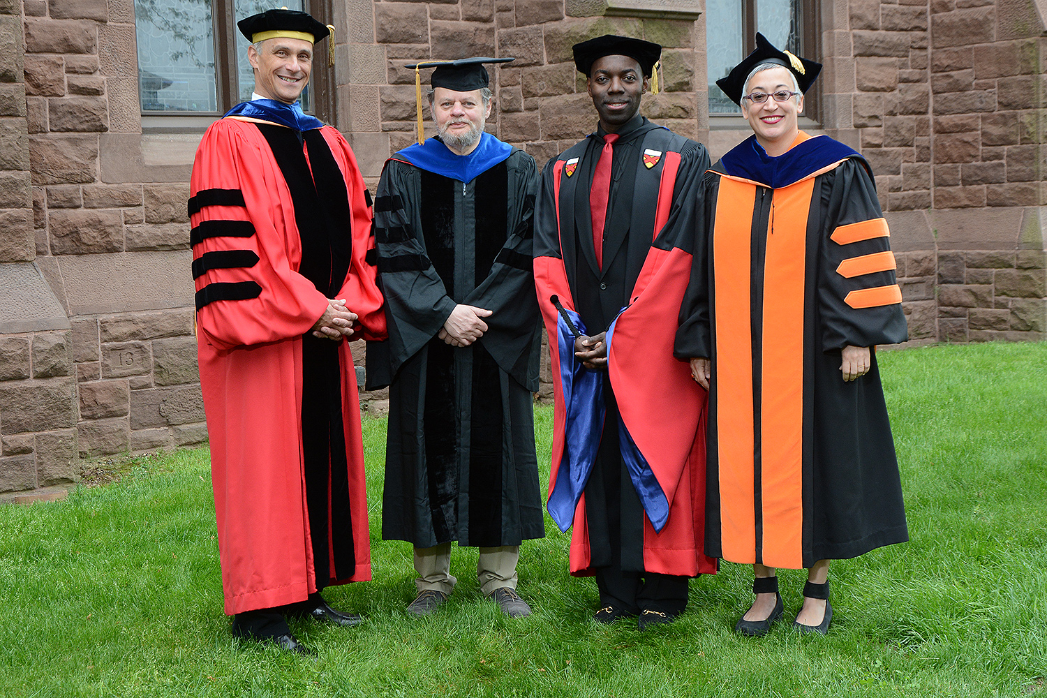 Wesleyan President Michael Roth honored James Lipton, professor of computer science; Demetrius Eudell, professor of history; and Sally Bachner, associate professor of English with Binswanger Prizes for Excellence in Teaching during the 184th Commencement Ceremony on May 22. (Photo by John Van Vlack)