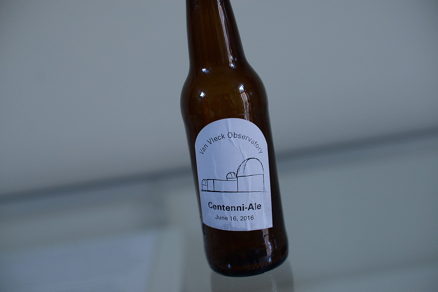 Roy Kilgard, support astronomer and research associate professor of astronomy, brewed Centenni-Ale for the occasion.